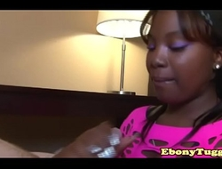 Ebony amateur tugging with two hands