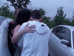 A girl is undressing in a car on her way to a public dogging sex gang bang orgy