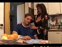 mom is comforting her sad son by giving him boobjob, blowjob in the kitchen and letting him fuck her