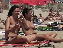 HOT TOPLESS BRUNETTE ON THE BEACH more on http://www.allanalpass.com/CMQ95