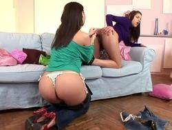 Horny brunette sucks girlfriend's ass with strap-on dildo